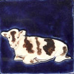 Cow resting cobalt, white and brown